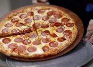 أميركية تشتري بيتا بالبيتزا