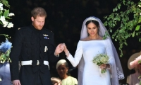 الأمير هاري وميغان ماركل زوج وزوجة. لقباهما: دوق ودوقة ساسيكس