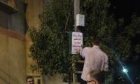 تعليق لافتات في احياء ام الفحم استقبالا لرمضان