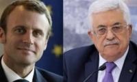 الرئيسان عباس وماركون: انهاء الصراع لا يتحقق الا بحل الدولتين