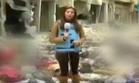 فضائية سورية تبث تقريراً لمراسلة تقف بين جثث القتلى