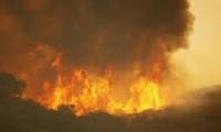 حريق احراش ضخم يجبر الالاف على ترك منازلهم في ولاية ايداهو الامريكية